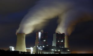 Steam rises from the chimneys of a coal power plant in Germany