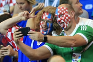 Supporters of Team Croatia take a selfie during a 2018 FIFA World Cup Group D football match against Iceland