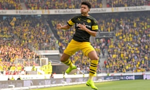 Jadon Sancho takes to the skies after scoring Borussia Dortmund's opening goal at Stuttgart. The win extends their lead at the top of the Bundesliga to four points.