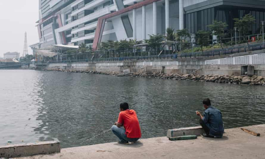 Men fishing at the back side of Green Bay Mall of North Jakarta.