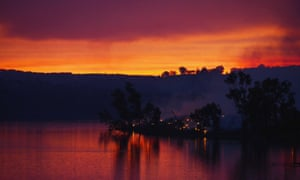 Embers glow against the smoke-filled sunset near Gumeracha in the Adelaide Hills.