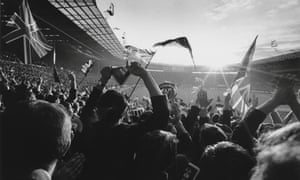 Fans wave flags before the 1966 World Cup final at Wembley.
