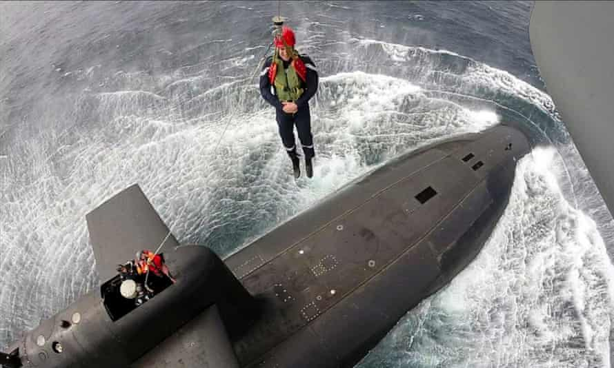 Emmanuel Macron is winched onto the French submarine Le Terrible.
