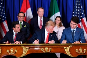 Mexico's President Enrique Pena Nieto (L) US President Donald Trump (C) and Canadian Prime Minister Justin Trudeau sign a new free trade agreement