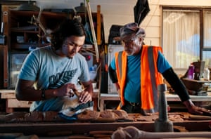 Kauri (Tekaurinui Robert) Parata, watched by his father Hori Parata, carves a traditional Maōri design at their home in Whangārei. Kauri is a member of the Manu Taupunga group that is the organising arm of the whale-body recovery operation started by his father, Hori Parata