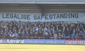 Fans make their feeling known at a match between AFC Wimbledon and York City.