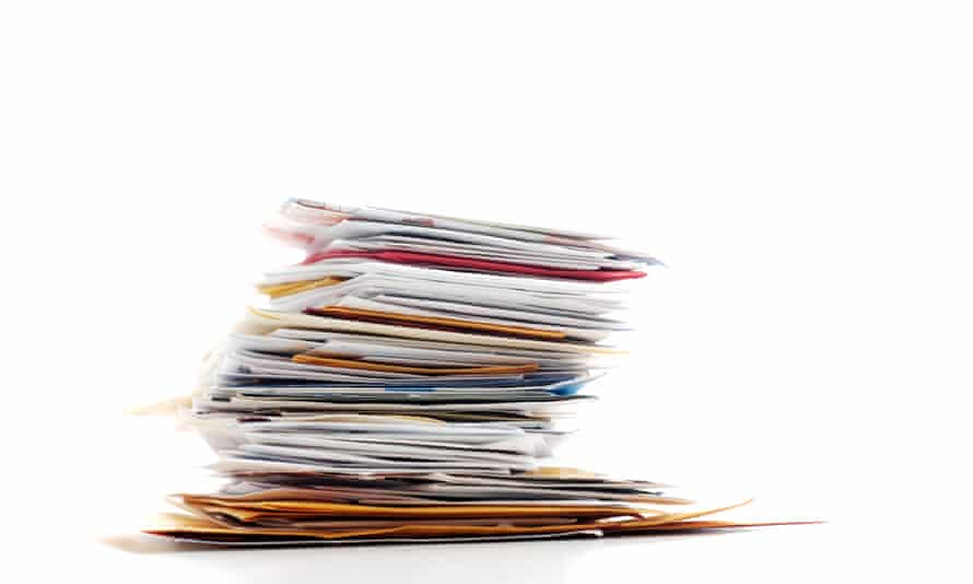 A teetering stack of junk mail and business post