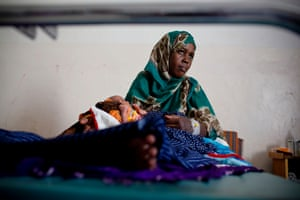 Mariam Abdullahi comforts her newborn baby in the maternity ward of Mudug teaching hospital. Across Somalia, only 28% of babies were born in hospitals or clinics in 2017. Abdullahi said: 'During a visit to the doctor before giving birth they told me the baby was large and I knew I would have care in a hospital'