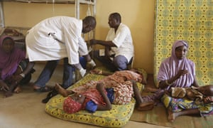 Doctors in Yola attend to a sick child rescued by Nigerian soldiers from Boko Haram extremists.