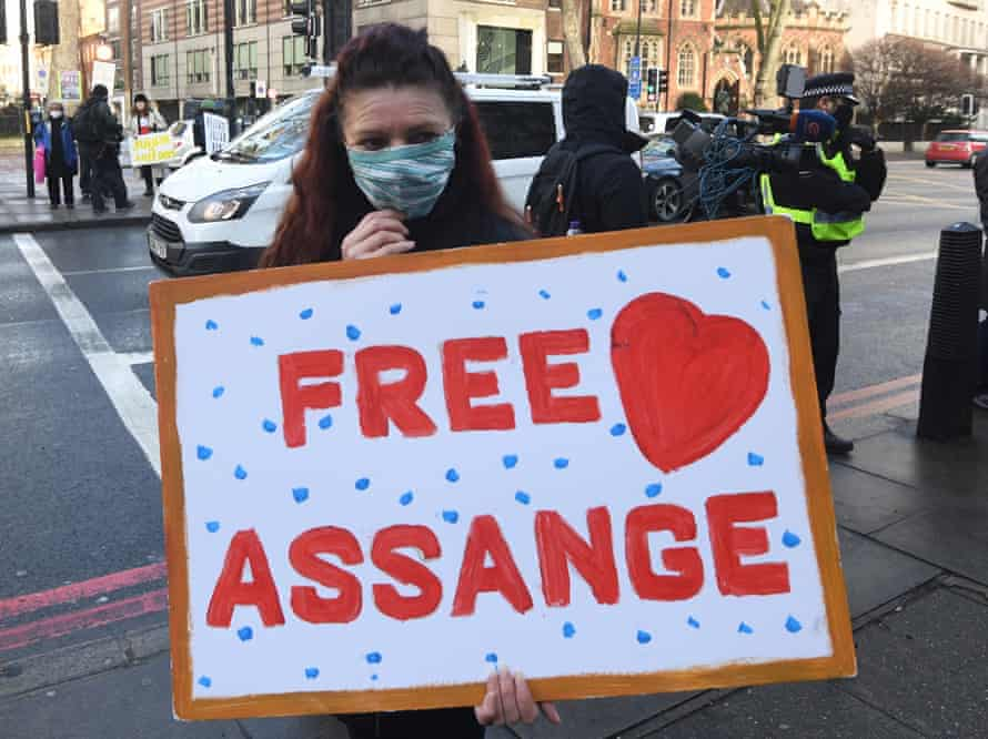 A supporter of Wikileaks founder Julian Assange holds a banner in central London, 6 January 2021.