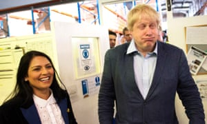 Boris Johnson and Priti Patel meet workers at clothing and uniform manufacturers Simon Jersey in Accrington, Lancashire, during a visit as part of the Vote Leave EU referendum campaign. Quite what the joke was remains unclear.