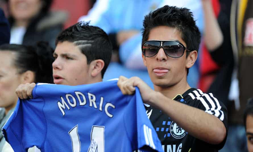 A Chelsea fan holds a shirt with Luka Modric's name on the back during the summer of 2011, when the player was pushing for a move to Stamford Bridge