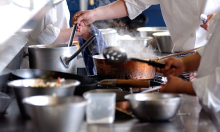 Chefs cooking in a restaurant