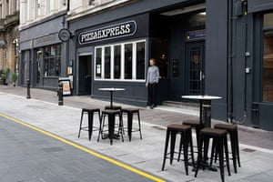 Empty tables outside a Pizza Express restaurant on October 18, 2020 in Cardiff, Wales.