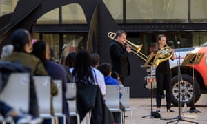 Members of the New York Philharmonic perform in Hearst Plaza at Lincoln Center as part of Lincoln Center's Restart Stages in New York City. - The musicians performed for an audience of 150 healthcare workers on World Health Day, after being shut down due to the pandemic last March.