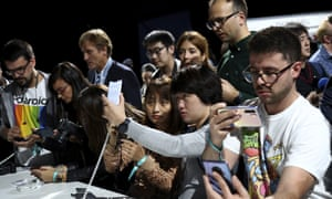 Visitors take pictures of new devices of China's smartphone manufacturer Huawei during an event in Germany