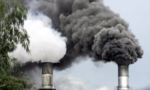 Black smoke is emitted by a sugar mill in Manila, Philippines