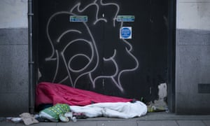 A homeless person sleeping rough in Manchester