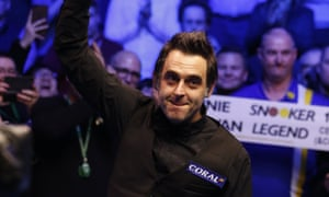 Ronnie O'Sullivan punches the air in celebration after his 35th career title.
