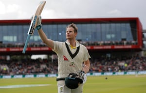 Australia's Steve Smith raises his bat as he receives a standing ovation for his magnificent knock of 211.