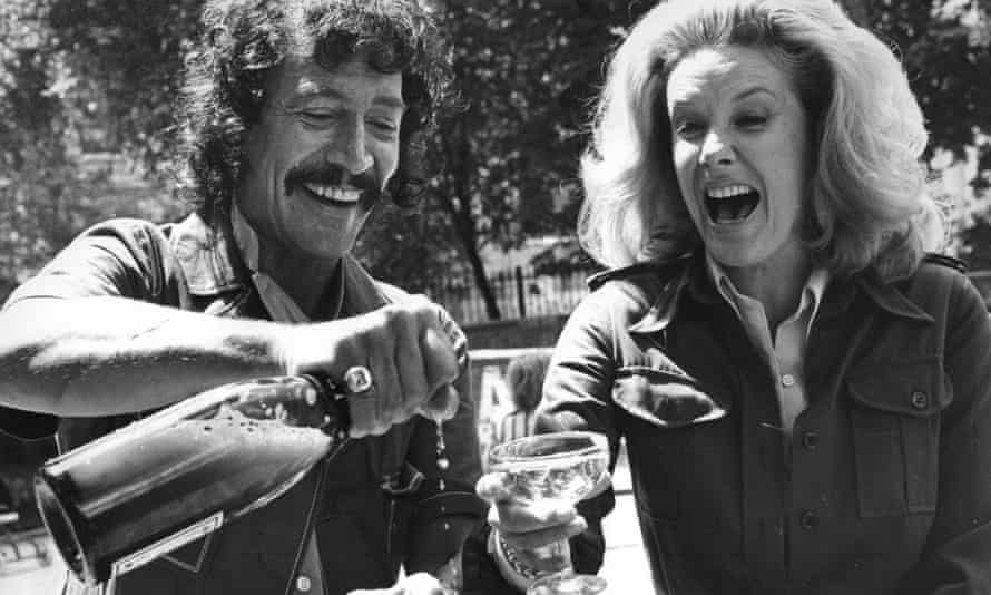 Peter Wyngarde And Sally Ann Howes share champagne. Both were appearing in The King And I, 1973.