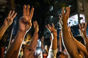 People make three-finger salutes in Yangon