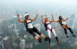 Kuala Lumpur, Malaysia Three of more than 120 parachutists leap from the 312-metre Kuala Lumpur Tower for the international base jumping competition