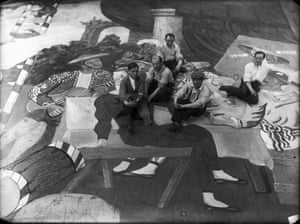 Pablo Picasso, second from right, sitting on the front cloth for Parade, staged by Diaghilev's Ballets Russes at the Théâtre du Châtelet, Paris, in 1917.