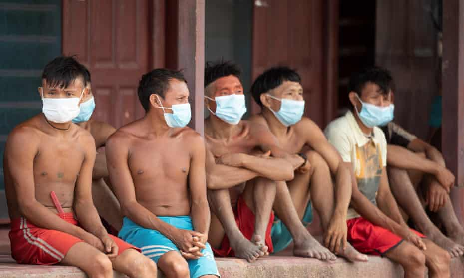 Yanomami people wear face mask as they attend a health brigade by the Brazilian army in Alto Alegre municipality, Roraima state, last June.