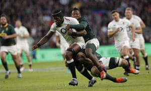 Maro Itoje of England tackled by Duane Vermeulen and Sbu Nkosi.