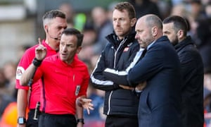 Refere Keith Stroud discusses homophobic chants from the crowd with Millwall manager Gary Rowett and Reading's Mark Bowen.