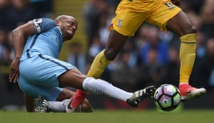 Vincent Kompany tackles Wilfried Zaha
