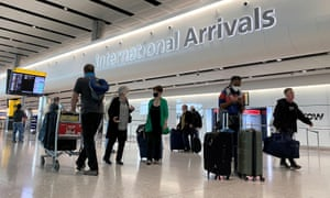 Travellers at Heathrow airport in London