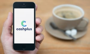 A man looks at his iPhone, which displays the Cash Plus logo