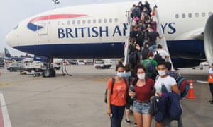 Niamh Fitzgibbon,27, Ellie Harper 32, Clarice Thorne, 27, boarding one of the BA repatriation flight from Lima to London