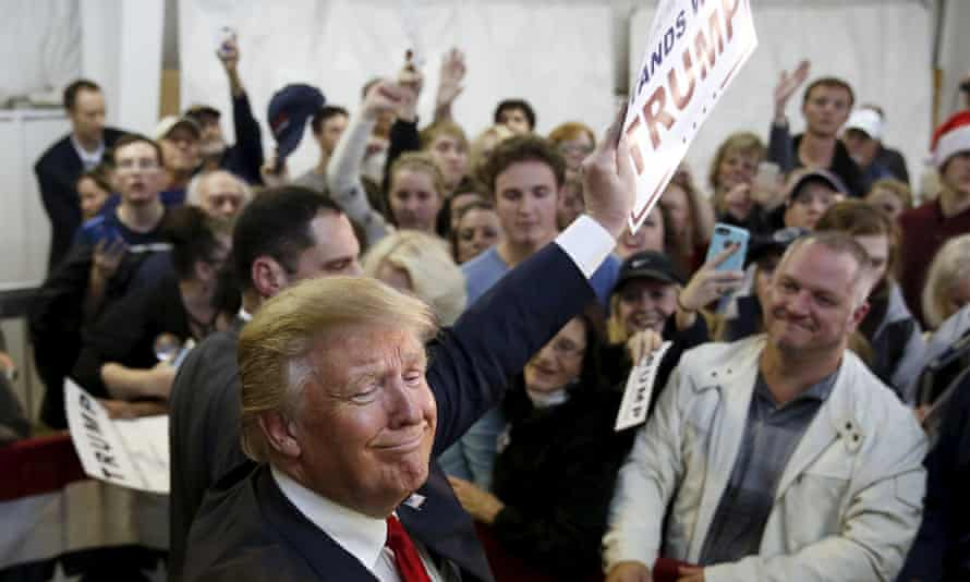 Donald Trump waves to a crowd after a campaign rally in Manassas, Virginia.