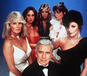 Joan Collins with John Forsythe, Linda Evans and other members of the Dynasty cast in 1983.