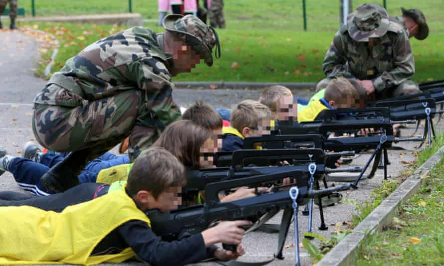 Pupils at a primary school in Flastroff, in north-eastern France, take part in an exercise using unloaded Famas assault rifles.