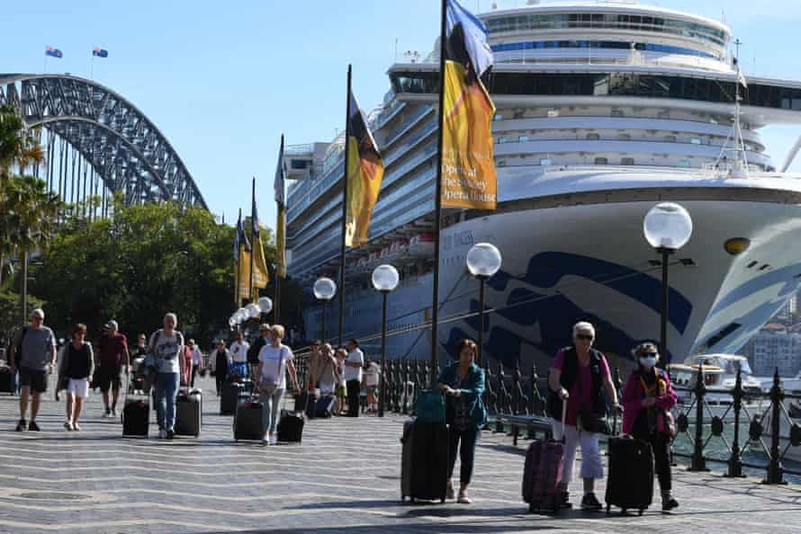 Cruise ship passengers disembark from the Princess Cruises owned Ruby Princess at Circular Quay in Sydney, Thursday, March 19, 2020.