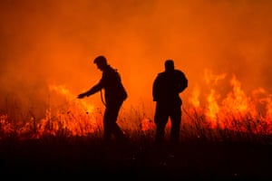 Firefighters tackle a forest fire next to the village of Bribir, Skradin, Croatia