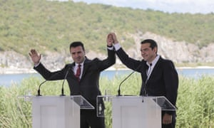 The Greek prime minister, Alexis Tsipras (right), and his Macedonian counterpart, Zoran Zaev, raise their hands during a signing agreement for Macedonia's new name – North Macedonia