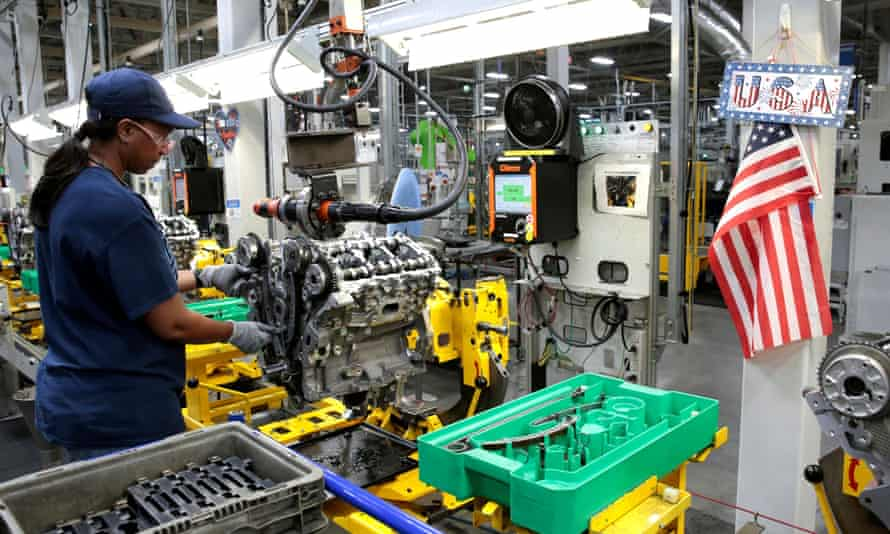 A General Motors assembly worker works on assembling a V6 engine last year. The ventilator operation will look significantly different.