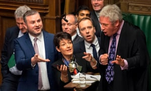 Bercow surrounded by MPs during the weekly PMQs in the House of Commons.