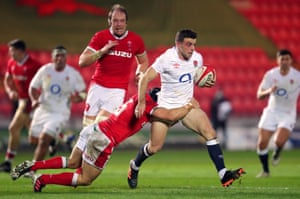 George Ford is tackled by Wales' Leigh Halfpenny.