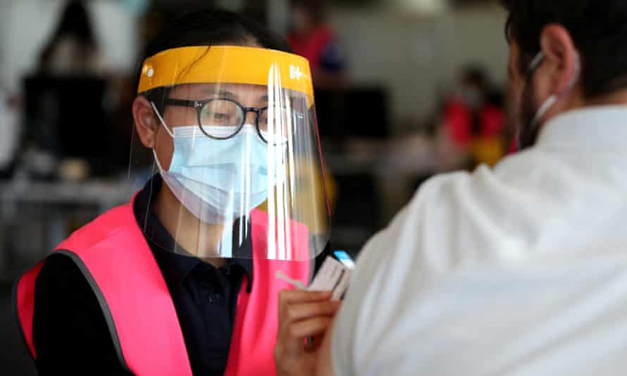A nurse administers a Pfizer vaccine at Qudos Bank Arena vaccination clinic in Sydney