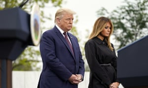 Donald Trump and First Lady Melania Trump listen during a prayer at the 9/11 memorial event.