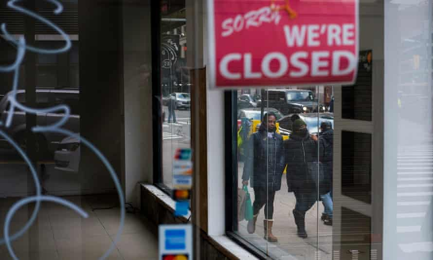 Pedestrians walk past a closed store in New York, New York on 8 January 2021.