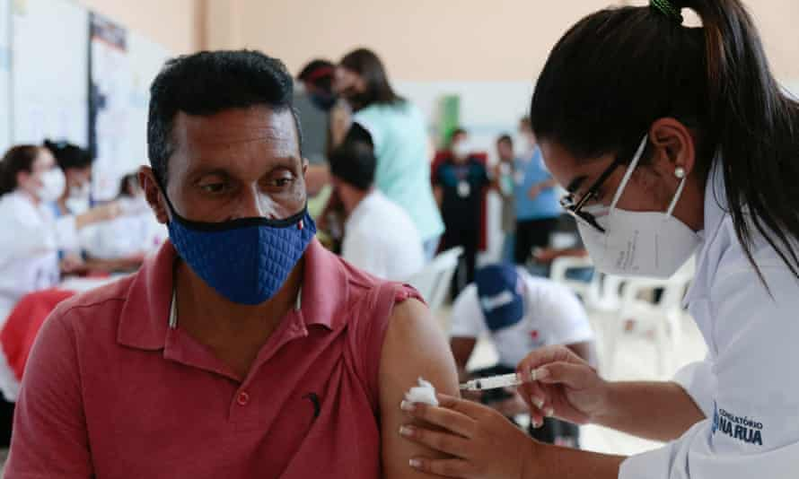 A homeless man receives a Covid-19 vaccination in Sao Paulo, Brazil.