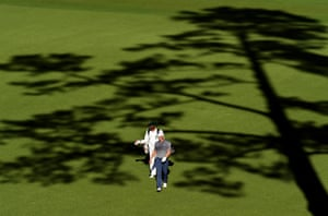 Jordan Spieth and caddie Michael Greller walk to the 14th tee