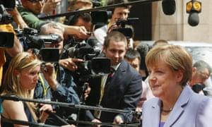 The pressure mounts on Angela Merkel to help coordinate a deal